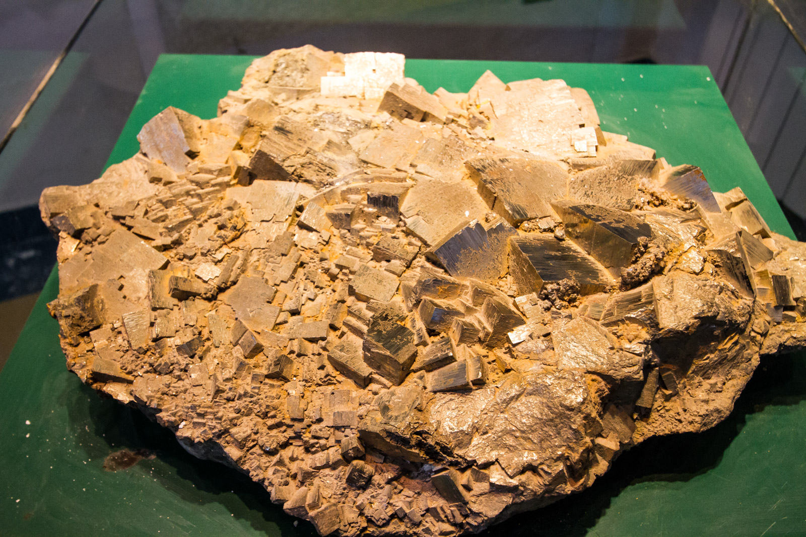 Pyryte has a gold lustre to it, and was used significantly for sulphuric acid production before oil superseeded it. Notice the cyrstalisation on the mineral.