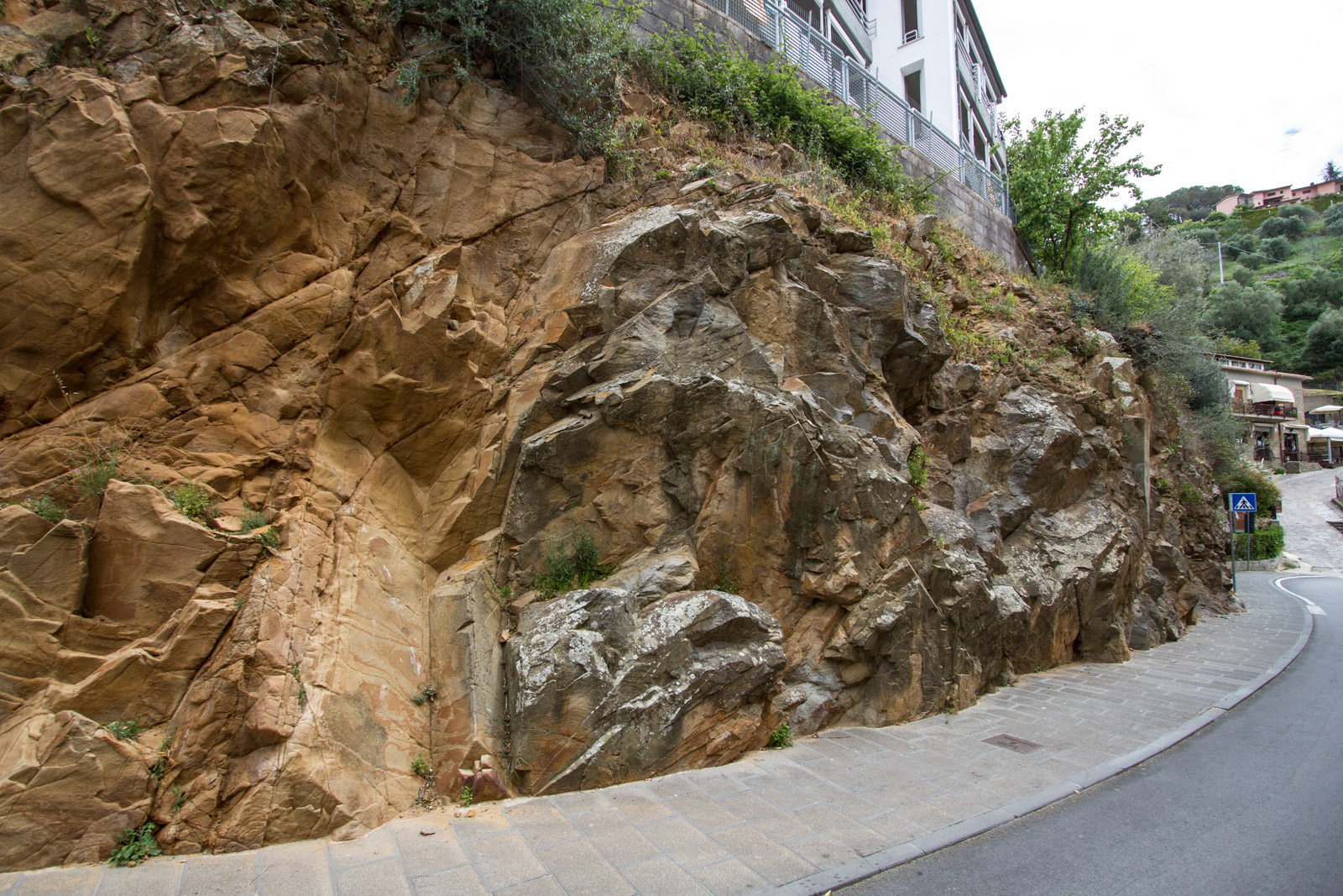 The importnace of the rocks is evident as the road cuts through a mineral outcrop.