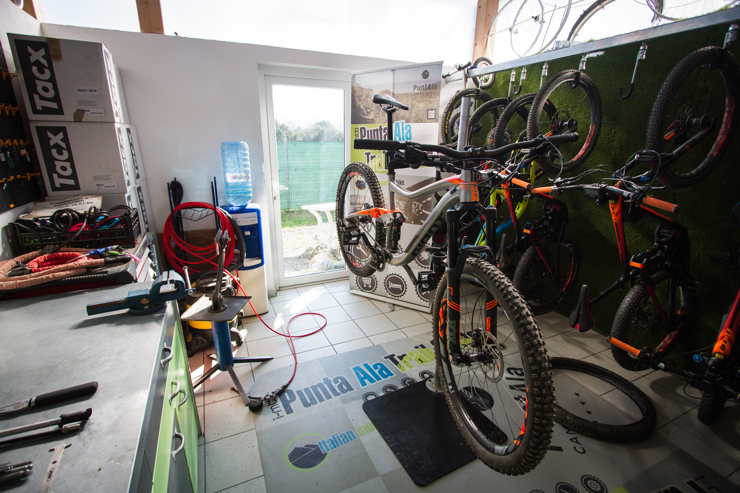 Our Giant Trance Enduro bike in the stand at the Punta Ala Trail Center Repair shop.